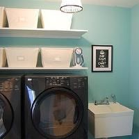 laundry/mud rooms - tiffany blue room, tiffany blue laundry room, tiffany blue walls, tiffany blue paint, tiffany blue paint color, tiffany blue wall paint, black washer and dryer, washer and dryer on platform, laundry room shelves, laundry room shelving, laundry room bins, laundry room, laundry room sink, Open Canvas Bins, Pottery Barn Beaded Pendant,