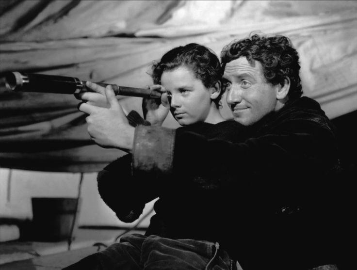 """""""Capitanes intrépidos"""" (Captains Courageous, 1937). Esta película é fixa cada ano na miña aula. Unha lección de vida. Ser vs. Ter. Un rapaz (Freddie Bartholomew) atopa alguén que por primeira vez na súa vida confía nel: o mariñeiro Manuel (Spencer Tracy). O meu alumnado adora este filme."""