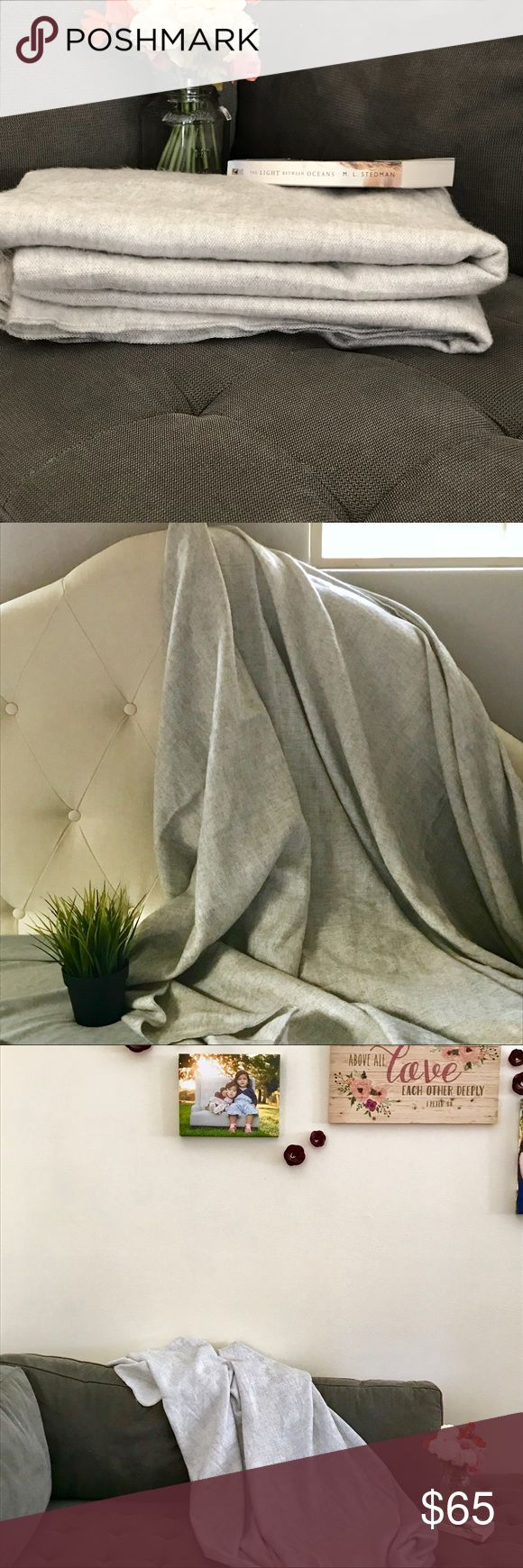 """Alpaca Blend Oversized Throw Blanket from Ecuador This beautiful oversized blanket throw was purchased in an indigenous town in Ecuador known for their handmade crafts and textiles.   Made of and Alpaca Wool blend, this heather gray blanket has a soft buttery texture.  It is thin but extremely soft and warm!  You will not be disappointed. This can serve as a cover over a twin size bed. Has one snag as shown but overall in great condition.  86"""" x 58"""" Other"""