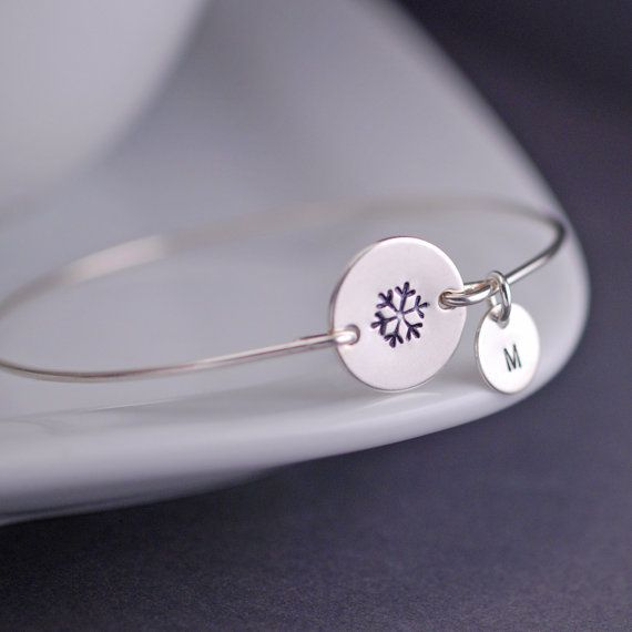 There won't be much snow in my future living in Phoenix, AZ.  But I couldn't help myself and made a new personalized snowflake bracelet today to remind me of my winters growing up in Boston!