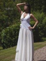 Hernyóselyem muszlin esküvői ruha csipkével, nyakbakötős fűzővel. Mérete38 Ára:110000 Ft.