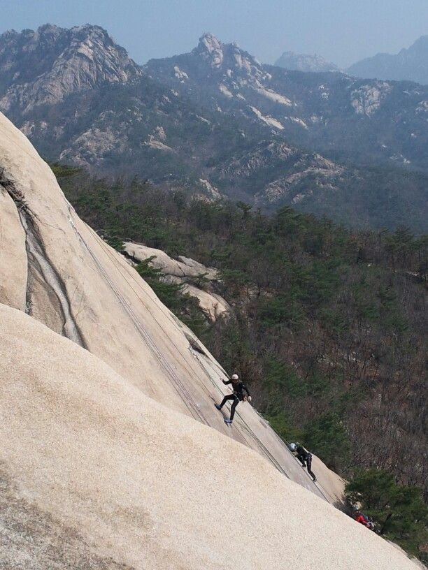 Rock climbing at the Bukhansan Mountain, Seoul, South Korea. .   Just a 20 minute drive away from the downtown Seoul City Hall, spring 2014