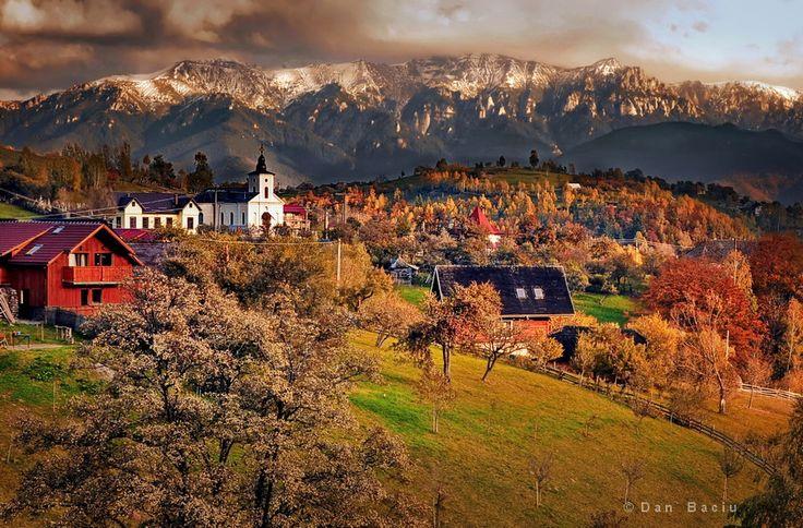 Magura village in front of Piatra Craiului massif, Btrasov, Romania