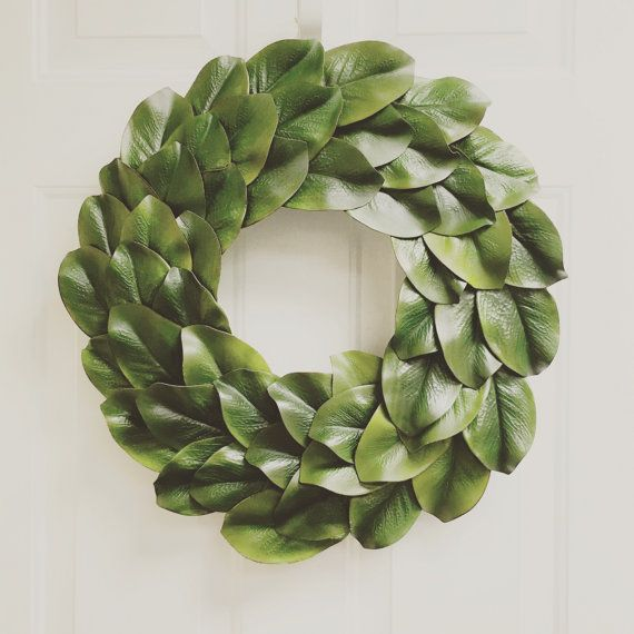 23 faux magnolia leaf wreath  This listing is for a beautiful, high quality, FAUX magnolia wreath, measuring 23 inches. The wreath has a hidden string of jute for hanging, however, I can add a ribbon of the color of your choice if youd like the wreath to hang from a bow.  Simply set on a shelf or hang up anywhere to add a touch of Joanna Gaines Fixer Upper style to your home decor, and at a fraction of the price!  There are so many options for decorating with this luxurious wreath in…