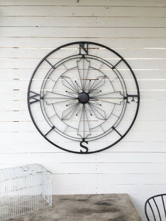 Metal compass makes a bold statement on a large wall space enhancing