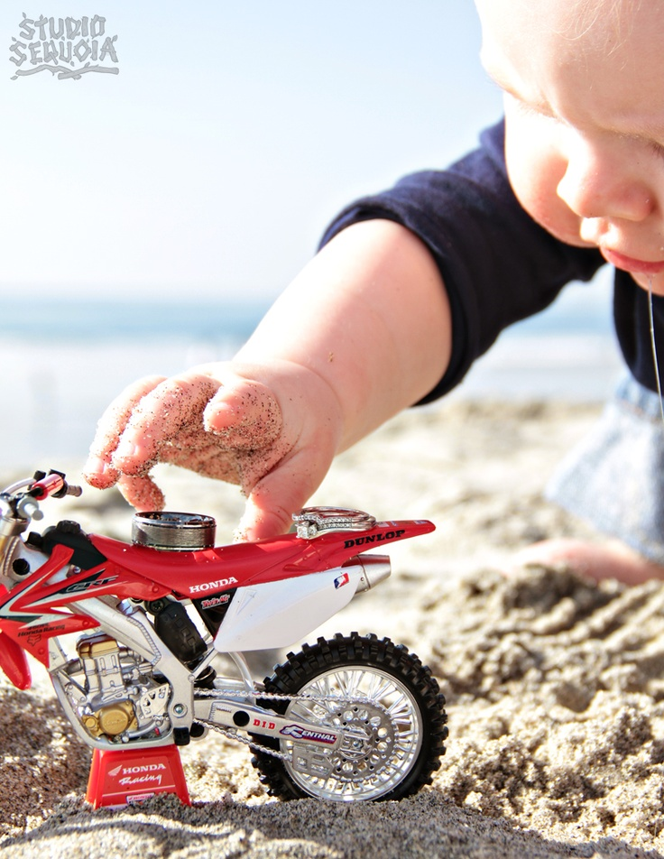 Love the incorporation of the couple's little baby and the toy dirt bike, all the mom's idea!