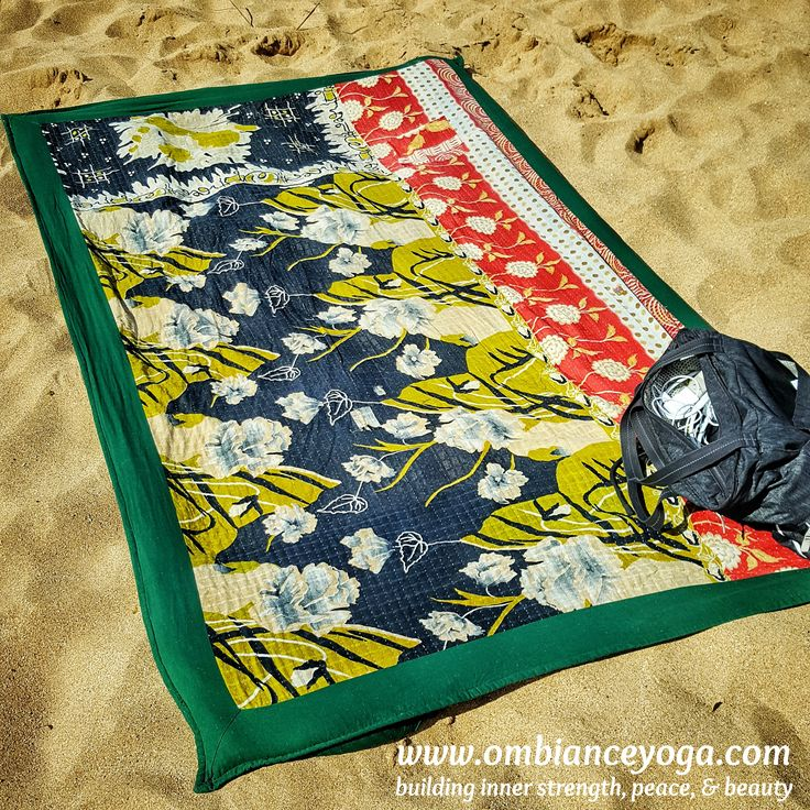 It was so windy on the beach yesterday. I watched so many frustrated sunbathers struggling to keep their beach towels from blowing away. Not a problem with my beautiful #twistedguru beach yoga mat. The underside is equipped with 4 corner pockets that fill with sand so I can suntan on the windiest days. So smart! | Twisted Guru yoga mat | beach towel | travel tips | beach yoga | travel blanket