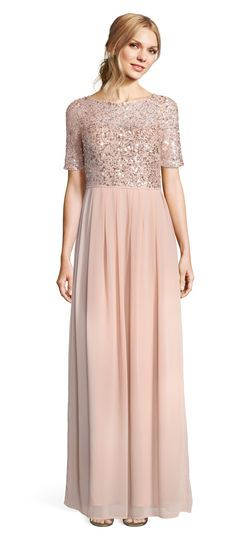 This formal dress features a sequin lace bodice with a boat neckline and a sheer neckline, back, and short sleeves. The pleated chiffon skirt adds an ethereal touch to this sparkling gown. A deep v-back with hidden zipper closure completes this beaded dress. A neutral or sequin heel and sequin clutch will complete this look for galas or bridal parties.
