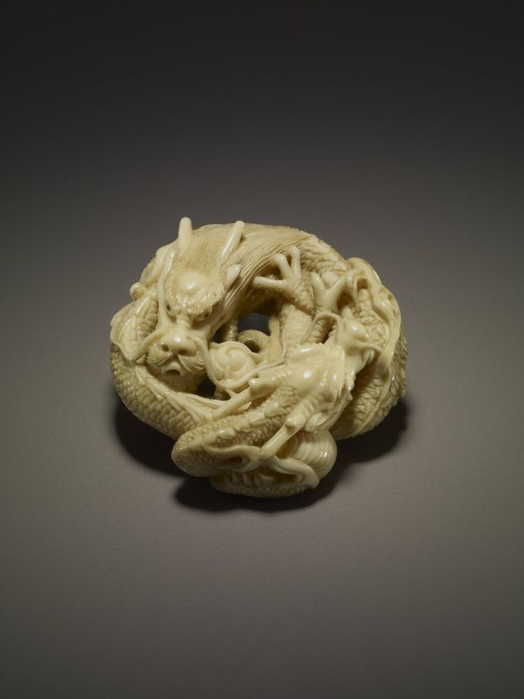 Netsuke. Two dragons round a jewel. Made of ivory. // © The Trustees of the British Museum