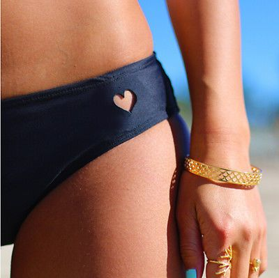 "Brazilian+style+bikini+bottoms  Heart+cut+out    Material:+Polyester  Color:+Black    (S)+  Waist:+24""  Hips:+33""    (M)+  Waist:+26""  Hips:+35""    (L)+  Waist:+28""  Hips:+37""    (XL)+  Waist:+30""  Hips:+39""    Shipping:  Ships+within+1-7+business+days.  Delivery+takes+10-25+business  days+once+s..."