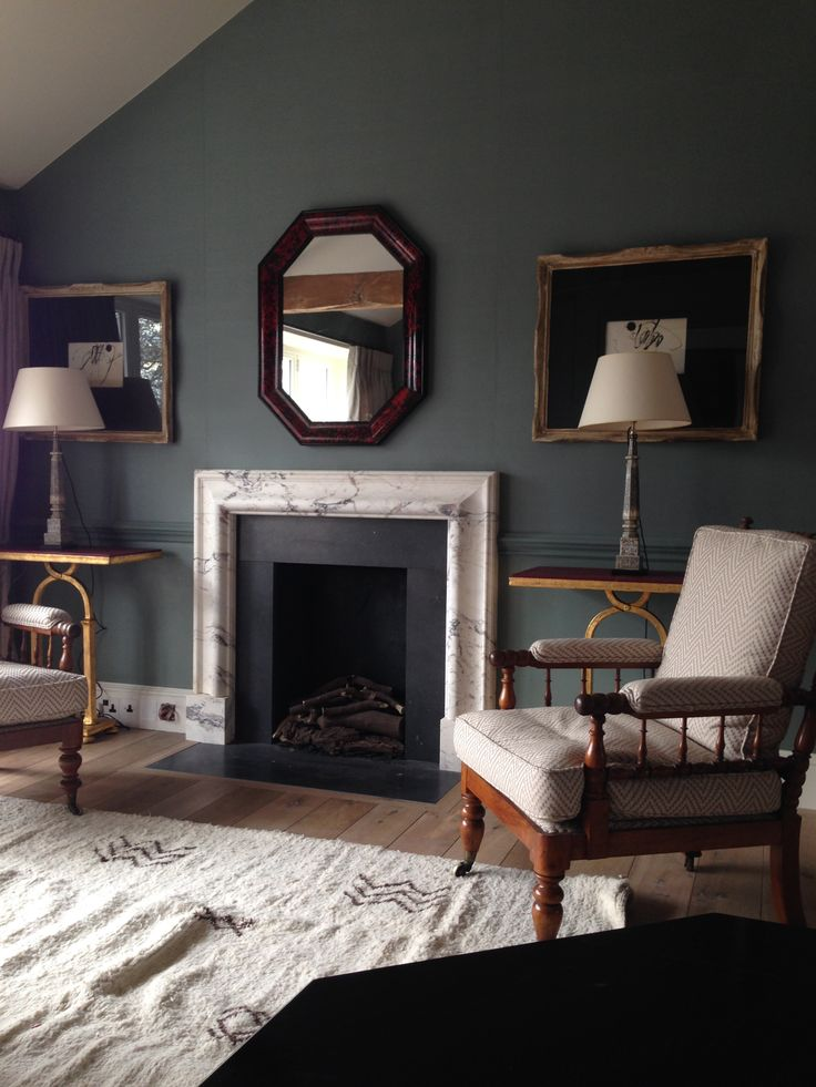 Drawing room detail; Pair of chairs c.1880 , Large tortoiseshell mirror c.1860 pair of tables by Soane Britain, Pair Lamps c.1820, Beni Ourain carpet. Silk wallpaper by De Gourney , new bolection moulded fire surround, new timber floor. London SW1