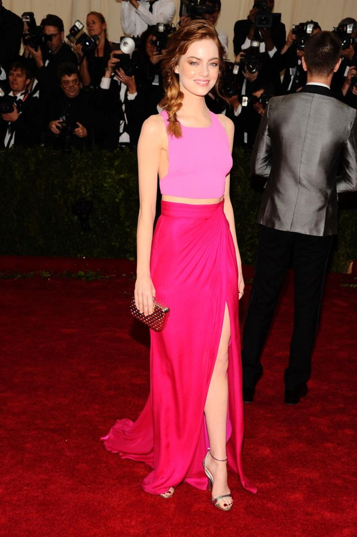 Emma Stone flashed her tiny waist in a pink two-tone Thakoon dress at the Met Gala on May 5, 2014.