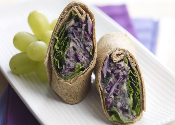 Rolled up in a whole-wheattortilla are avocado, whitebeans, lettuce, and shreddedpurple cabbage that pack apowerful purple punch in thisdelicious vegetarian wrap.