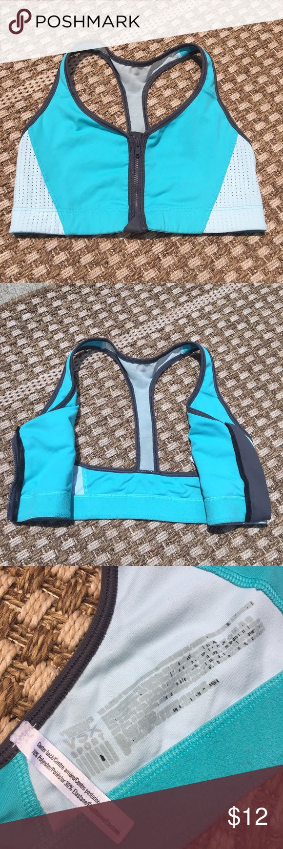 Blue Zip Up Victoria's Secret Sports Bra Worn a few times, the tag is peeling off. Still in great condition, nothing else wrong. Zips up the front, no padding but still supportive. The back is mesh. I don't know what size it is, but I usually wear xs or 32b Victoria's Secret Intimates & Sleepwear Bras