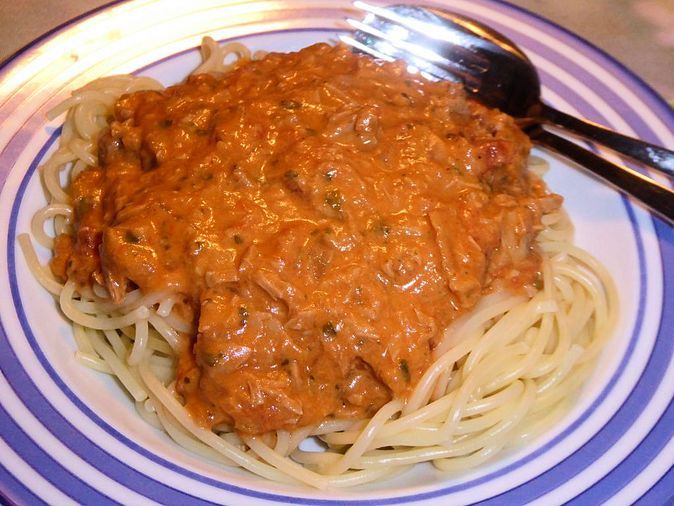 Pasta in light, creamy tuna-tomato-cheese sauce