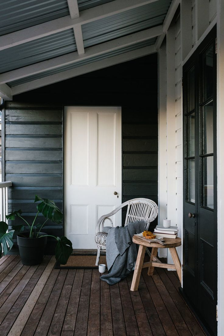 Australian country farmhouse verandah with black painted weatherboards - Cathy & Kirstie Penton, Meringandan. Photography by Marnie Hawson for Country Style magazine - see more at https://www.marniehawson.com.au/interiors/#/cathy-kirstie-penton/