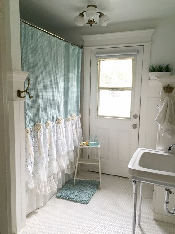 Little old bathroom all dressed up with a fancy shower curtain. Hallstrom House