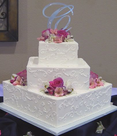 Simple and pretty wedding cake- could do borders of coffee beans around cake edges, and scatter some where the flowers are?