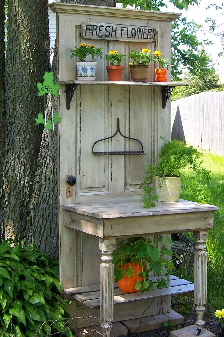 Constructed this from an old door, half a table and the metal part of a rack. It makes a nice accent in the corner of our yard between two flower beds.                                                                                                                                                      More