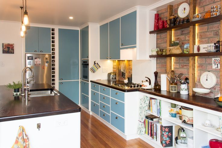 1950's style retro kitchen - Solid walnut tops, corian splash back, exposed & restored brickwork, in-frame hand-painted doors, walnut shelf fiddles, custom pantry & concealed TV