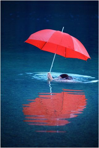 what if you had someone standing up soaking wet from swimming with an umbrella above them <3