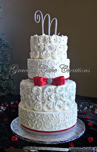 Elegant White Rosette Wedding Cake with Red Ribbon and Bling