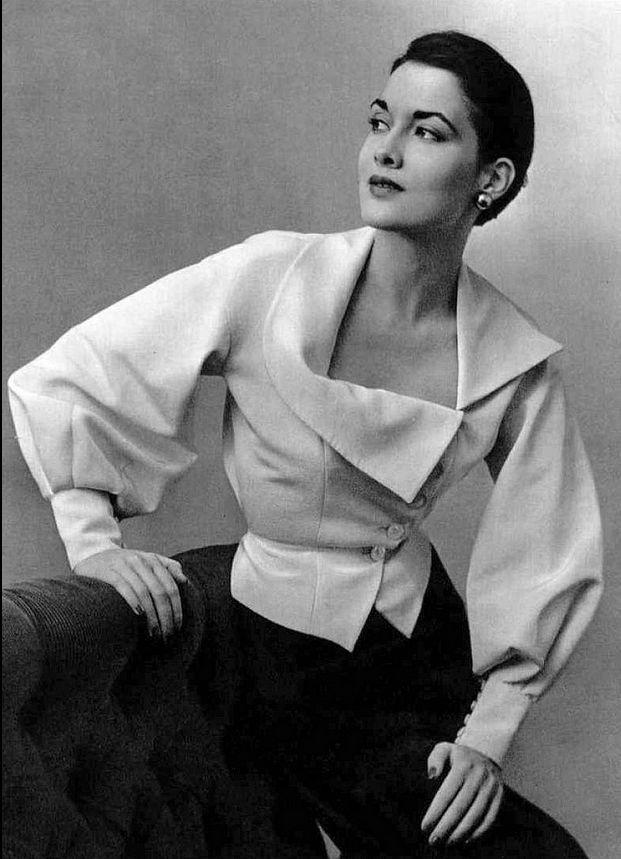 1950 Maxime de la Falaise in white Ottoman blouse with asymmetrical neckline by Marcel Rochas, photo by Pottier,