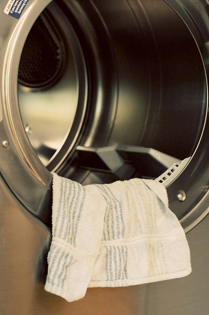 Soak a hand towel in fabric softener. Squeeze out any remaining drops from the towel.    Hang it over a chair (or outside on a clothes line) to dry. You must make sure it dries completely (abt 3 days).   After the towel dries you just throw it in your dryer along with clothes and use it as a dryer sheet for 40-50 loads before soaking again.