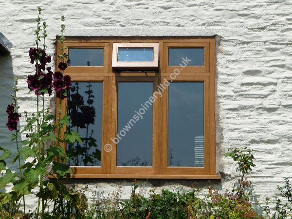 Triple Pane with fan light in Solid Oak Timber Windows by www.brownsjoineryltd.com