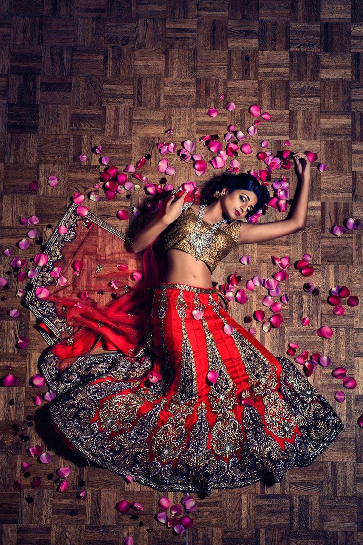 Photo by Studio Uma (www.studiouma.com) Stunning red and gold bridal lehenga. From Almas Tejani Desi Couture in Sugar Land, TX.