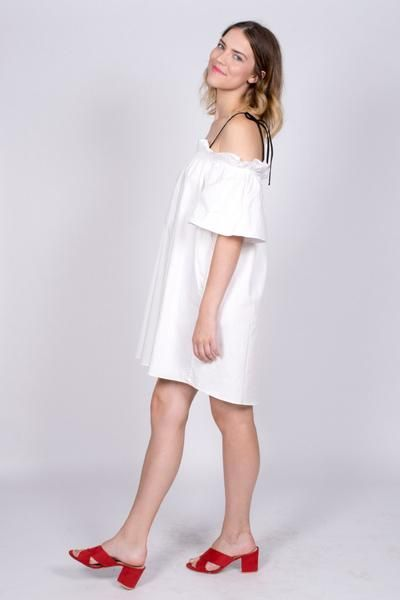 The perfect little crisp poplin dress for summer! White off the shoulder, boxy shift dress with ruffled neckline and tie straps. #poplin #dress