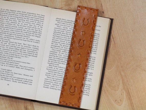 Handmade Bookmark, Leather Bookmark, Horseshoe Bookmark, Horse Lover Gift. Repin To Remember. #horseshoe, #horseshoebookmark, #horselover, #horselovergifts, #leatherbookmark, #bookmark, #bookmarker, #handmadebookmark, #handmadebookmarker, #leatherbookmarker, #leather, #leatheraccessories, #etsy, #etsyshop, #etsyfinds, #etsygifts, #handmade, #handmadewithlove, #tinasleathercrafts.