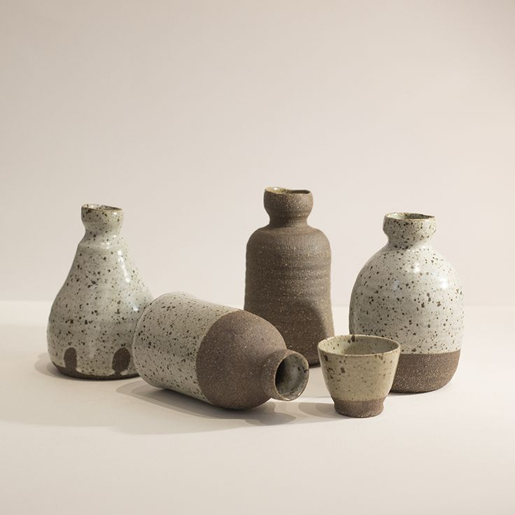 Bottles and cup by Andrei Davidoff.   Available in store and online.