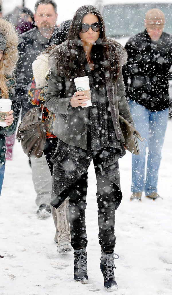 A solid snowstorm doesn't stop Demi Moore from wearing a great boot. Splash News  - HarpersBAZAAR.com