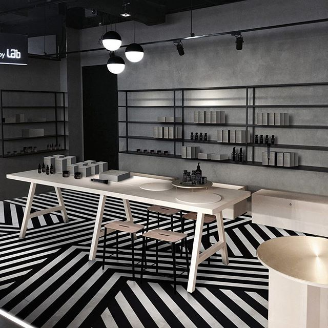 French designer Aurélien Barbry has installed a pattern of black and white stripes across the floor of Hong Kong beauty brand Facesss' Harbour City store. See more pictures at dezeen.com/interiors #interiordesign #interiors