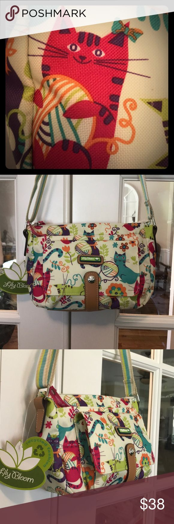 """🆕 Lily Bloom Feline Fun Crossbody This LilyBloom Kitty Crossbody has four, fully line large pockets!  The main compartment has one interior zippered pocket with a large slip pocket on the rear and a large zippered pocket in front. There is also another large front pocket with a flap that snaps close.  All zippers have the """"Lily Bloom"""" tag.  The bag is made of Lily Bloom signature fabric KARMA BLOOM made of recycled plastic bottles!   Roughly 10""""L x 6.5""""H x 5"""" including the front pocket. 💞…"""