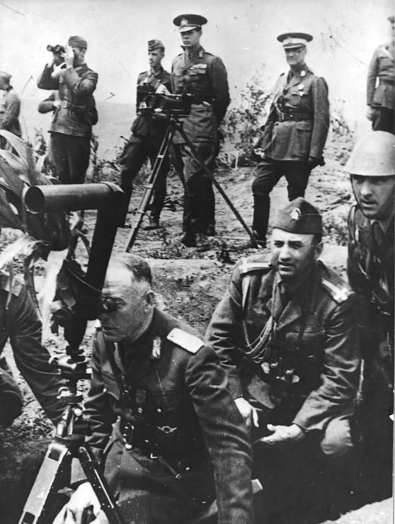 Ion Antonescu, Romania's military strongman and Hitler's ally, visits the Eastern Front and examines Soviet positions with scissor-glasses. The Romanians suffered annihilation at Stalingrad and never recovered.