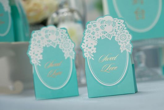 "50 Pieces of Aqua Colored Floral Laser Cut ""Sweet Love"" Wedding Candy/Chocolate Boxes For the Reception or Wedding Favor Gift Boxes.  Favor box can be filled with things like Jordan almonds, gourmet chocolates, jelly beans or any other candy of your choice if you choose to use it as a candy box..."