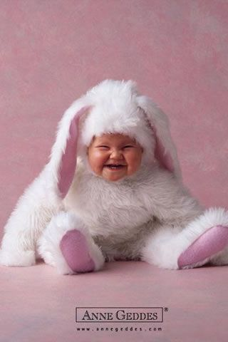 A laughing, little baby dressed as an Easter bunny! Anne Geddes