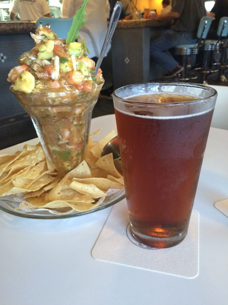 Goode's Seafood, Houston, TX -- CAMPECHANA DE MARISCOS AND A SHINER BOCK - A refreshing, Mexican-style seafood cocktail made  with a special blend of pico de gallo, fire-roasted   Anaheim peppers and diced avocados.