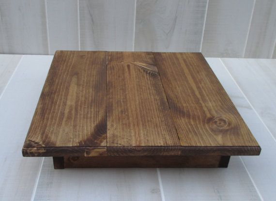This is the perfect rustic cake stand for your upcoming wedding. It measures 16x16x4 high. There is a 2 overhang on all sides from the base for