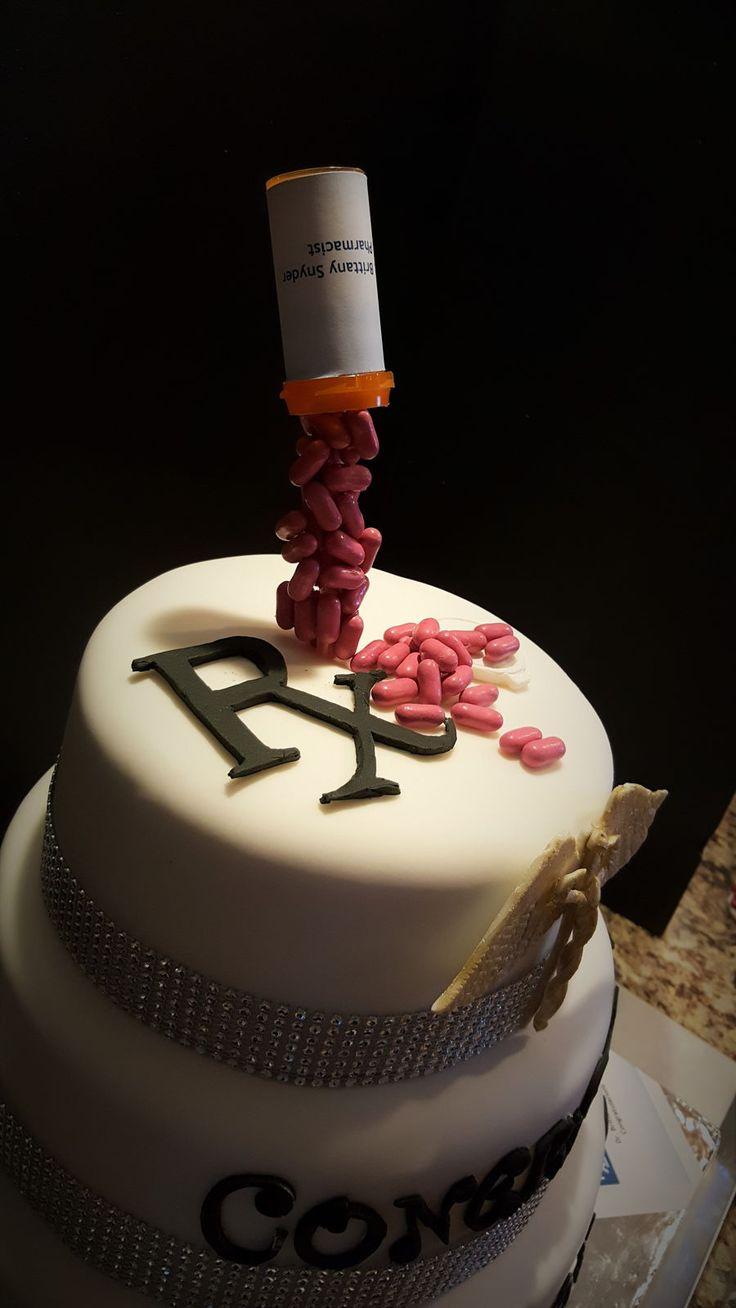 Pharmacist Cake/graduation Three tier cake buttercream with fondant covering, gumpaste cadeuses, good n plenty pills