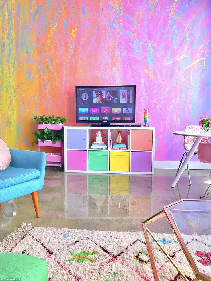 Customized: Though she bought a few pieces of furniture — like her couch and chairs — as-is, she also customizes things, like the white IKEA shelf system to which she added colorful cabinets