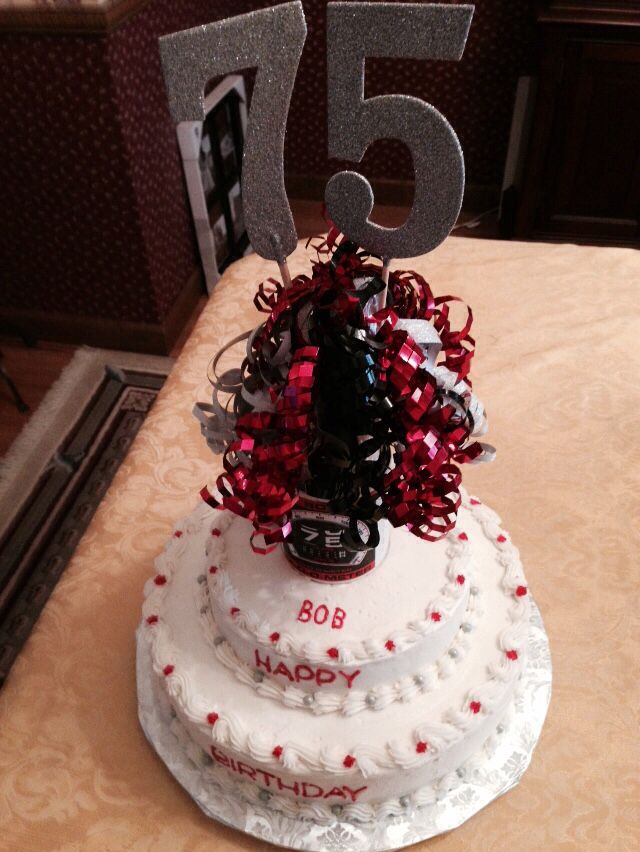 75 th birthday cake. French vanilla with raspberry filling. The cake topper was a special Orderedi for the birthday man!