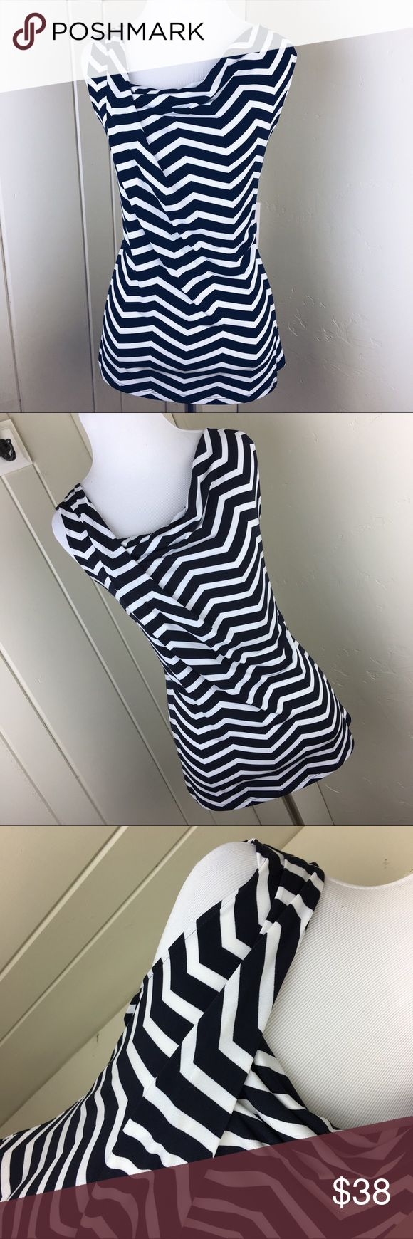 Ivanka Trump navy blue and white chevron blouse Brand new with tags. Super adorable and an awesome dressy blouse. Size medium. Ivanka Trump navy blue and white chevron blouse. Ivanka Trump Tops Blouses