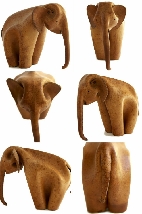 I want this guy!  beautiful leather Elephant from the 1960's by a German company called Deru and made from a single piece of leather that has been folded, molded, crimped and stitched.