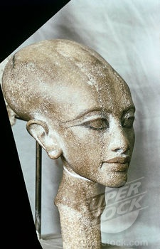 Statuette head composition representing one of Akhenaten's daughters with the classic Amarna elongated face and skull, and thick lips. Cairo Museum, Egypt.