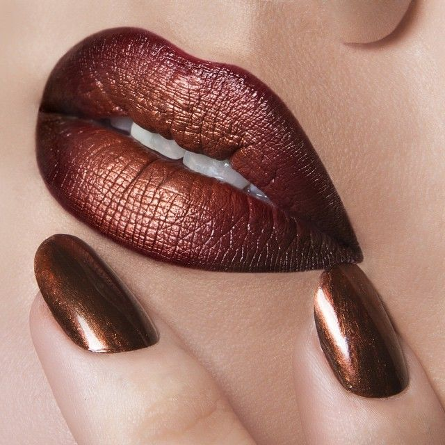 'Anita' Lip Tar Matte mixed with 'Authentic' Lip Tar Metallic, lined with OCC Pencil in 'Sybil'. On Nails: 'Black Metal Dahlia OCC Nail Lacquer mixed with 'Authentic' LooseColour.