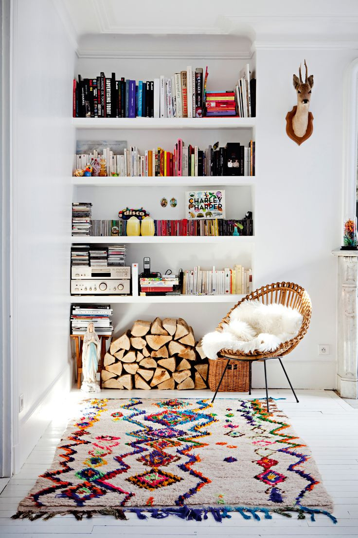 love the logs and the colour popping against the things on the shelves! the books are great, they add so much character