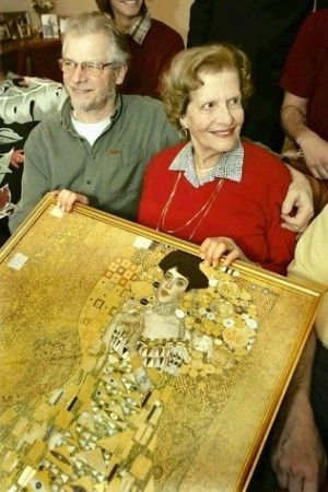 """Maria Altmann, with son Peter, holds a print of """"Portrait of Adele Bloch-Bauer."""" Maria Altmann, who escaped Nazi-occupied Vienna as a newlywed and returned to wage a triumphant fight to recover Gustav Klimt's iconic gold portrait of her remarkable aunt, has died. She was 94."""
